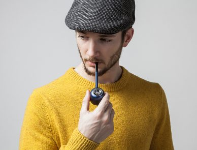 blue designer pipe with man smoking